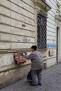 A Czech man posts a letter in a post box on Vodickova Street, on 19th March, 2018, in central Prague, the Czech Republic.