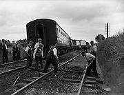 01/07/1960<br /> 07/01/1960<br /> 01 July 1960<br /> Westport - Dublin train derailed at Killucan, Co. Westmeath, clean up operation. Workmen clearing and repairing the line.