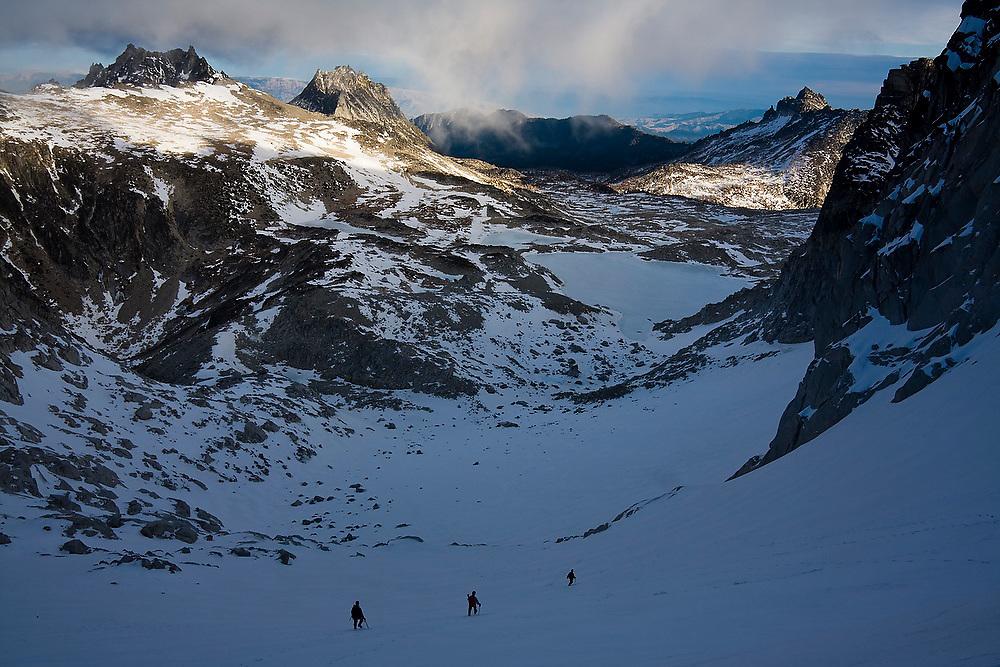 Climbers descend towards Asgard Pass from Dragontail Peak, Alpine Lakes Wilderness, Washington.