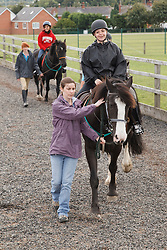 People with visual impairments having riding lessons.