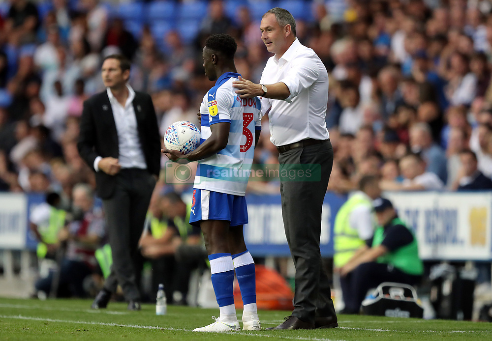 Reading manager Paul Clement and Andy Yiadom during the Sky Bet Championship match at the Madejski Stadium, Reading.