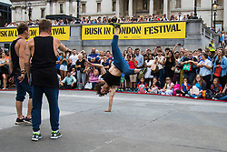 London, July 18th 2015. A group of acrobats thrill the crowds during the Busk in London Festival aimed at showcasing the outstanding talents of many of the capital's finest street performers, including musicians, magicians, living statues, jugglers, acrobats and bands.