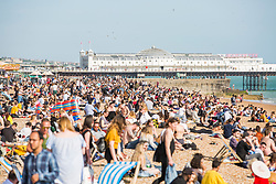 © Licensed to London News Pictures. 18/04/2018. Brighton, UK. Members of the public take to the beach in Brighton and Hove as sunny and warmer weather continues to hit the seaside resort. Photo credit: Hugo Michiels/LNP