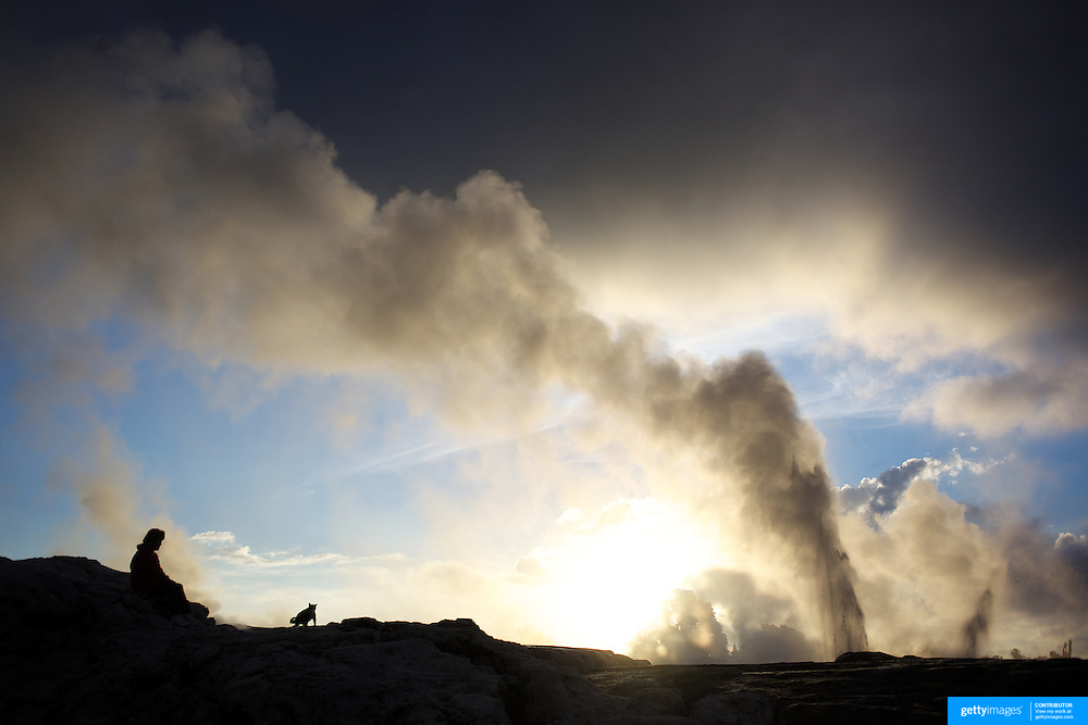A spectacular geyser at sunset at Te Puia, Rotorua. Te Puia is the premier Maori cultural centre in New Zealand - a place of gushing waters, steaming vents, boiling mud pools and spectacular geysers. Te Puia also hosts National Carving and Weaving Schools and  daily maori culture performances including dancing and singing. Rotorua, 9th December 2010 New Zealand.  Photo Tim Clayton.