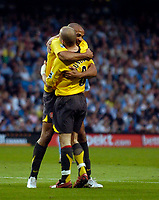 Photo: Jed Wee.<br /> Manchester City v Arsenal. The Barclays Premiership. 04/05/2006.<br /> <br /> Arsenal's Thierry Henry (L) celebrates with goalscorer Freddie Ljungberg.
