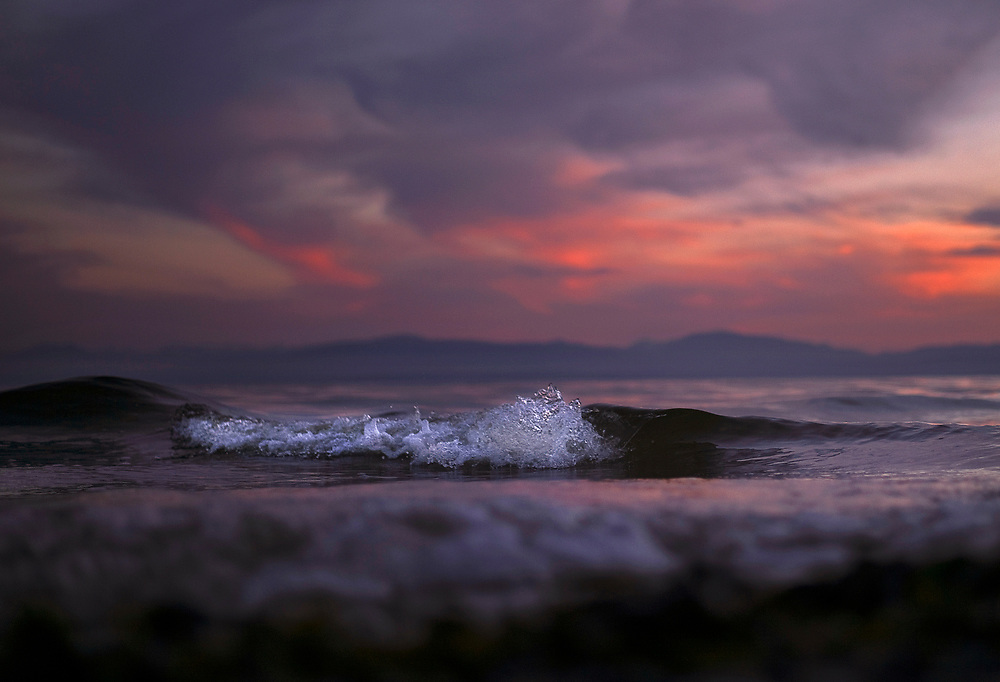 A wave comes ashore at sunset as the tide returns in Sechelt, BC. (2015)