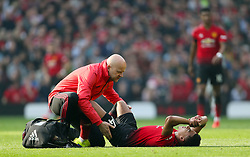 Manchester United's Jesse Lingard receives medical attention