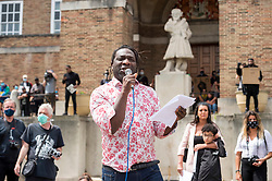 © Licensed to London News Pictures; 07/06/2020; Bristol, UK. MILES CHAMBERS, Bristol's first city poet laureate, gives an impassioned poetry reading at the Black Lives Matter protest rally and march through the city centre in memory of George Floyd, a black man who was killed on May 25, 2020 in Minneapolis in the US by a white police officer kneeling on his neck for nearly 9 minutes. During the Bristol event the statue of Edward Colston was torn down and thrown into Bristol docks. Edward Colston (1636 – 1721) was a wealthy Bristol-born English merchant involved in the slave trade, a Member of Parliament and a philanthropist. He supported and endowed schools, almshouses, hospitals and churches in Bristol, London and elsewhere, and his name is commemorated in several Bristol landmarks, streets, three schools and the Colston bun. The killing of George Floyd has seen widespread protests in the US, the UK and other countries, despite the restrictions due to the Covid-19 coronavirus pandemic. People had been advised by the Bristol Mayor and Avon & Somerset's Chief Constable not to attend the event due due to the coronavirus pandemic and the need to maintain social distancing to avoid the spread of the virus. Photo credit: Simon Chapman/LNP.