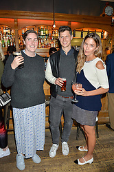Left to right, REBECCA GUINNESS, GEORGE NORTHCOTT and QUENTIN JONES at a quiz night hosted by Zoe Jordan to celebrate the launch of her men's ZJKNITLAB collection held at The Larrick Pub, 32 Crawford Place, London on 20th April 2016.