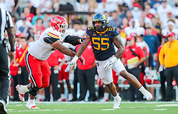 Sep 4, 2021; College Park, Maryland, USA; West Virginia Mountaineers defensive lineman Dante Stills (55) makes a move around Maryland Terrapins offensive lineman Spencer Anderson (54) during the fourth quarter at Capital One Field at Maryland Stadium. Mandatory Credit: Ben Queen-USA TODAY Sports