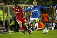 Photo: Rich Eaton.<br /> <br /> Birmingham City v Liverpool. Carling Cup. 08/11/2006. Mark Gonzalez left of Liverpool passes as Sebastian Larsson of Brimingham tackles