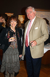 Writer BEL MOONEY and actor GEORGE BAKER at a party to celebrate the publication of an autobiography by the late Jack Rosenthal at The Fine Art Society, 148 New Bond Street, London W1 on 21st April 2005.<br /><br />NON EXCLUSIVE - WORLD RIGHTS