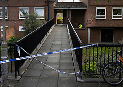 © Licensed to London News Pictures. 06/07/2021. London, UK. A cordon remains in place at a housing estate off Oval Place in south London where a 16 year old boy was stabbed to death last night. Police were called at around 23:45hrs on Monday, 5 July, to a teenager stabbed in Oval Place, SW8. Officers attended along with London Ambulance Service. The 16-year-old male was pronounced dead at the scene. Photo credit: Peter Macdiarmid/LNP