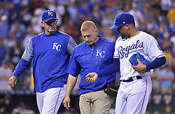 August 22, 2017 - Kansas City, MO, USA - Kansas City Royals relief pitcher Kelvin Herrera is escorted off the field with an injury in the ninth inning during a game against the Colorado Rockies at Kauffman Stadium in Kansas City, Mo., on Tuesday, Aug. 22. 2017. (Credit Image: © John Sleezer/TNS via ZUMA Wire)
