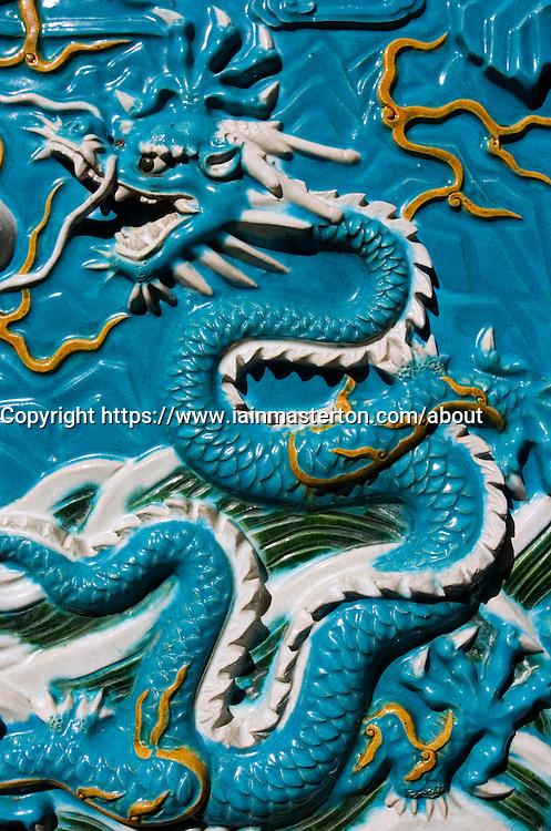 Detail of ceramic tiled wall with dragon at Confucius Shrine in Nagasaki Japan