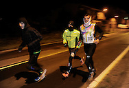 """People prepare to run in Lodosa early on March 26, 2015, Basque Country. The """"19th Korrika"""" is a relay of hand to hand baton passing without interruption over 11 days and 10 nights crossing many Basque villages and cities, totalling some 2300 kilometres in a bid to promote the basque language.The """"Korrika"""" this year end in Bilbao on March 29. (Ander Gillenea / Bostok Photo)"""