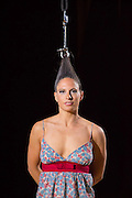 A performance artist who does hair hanging for a video project.