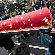LONDON, ENGLAND - FEBRUARY 07:  Shiite Muslim devotees carry a coffin in remembrance of Imam Husain martyrdom during the 29th Arbaeen Procession on February 7, 2010 in London, England. Arbaeen occurs 40 days after the day of Ashura, the commemoration of the martyrdom of Imam Husain in Karbala (Photo by Marco Secchi/Getty Images)