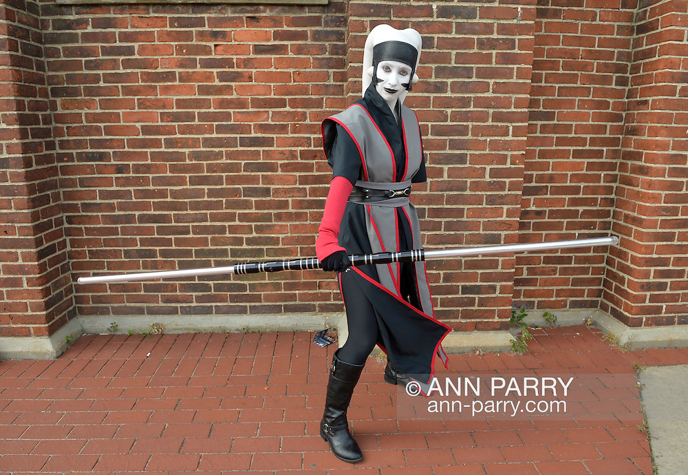 Garden City, New York, U.S. - June 14, 2014 - DANIELLE MATTES, of Staten Island, is holding a lightsaber and wearing a costume of Darth Necavi, at Eternal Con, the annual Pop Culture Expo, with costumes, Comic Books, Collectibles, Gaming, Sci-Fi, Cosplay, Horror, and held at the Cradle of Aviation Museum on Long Island.