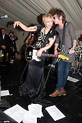 COURTNEY LOVE PERFORMING with lyrics in front of her, The Goodwood Ball. In aid of Gt. Ormond St. hospital. Goodwood House. 27 July 2011. <br /> <br />  , -DO NOT ARCHIVE-© Copyright Photograph by Dafydd Jones. 248 Clapham Rd. London SW9 0PZ. Tel 0207 820 0771. www.dafjones.com.