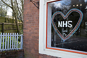 Local response to Coronavirus is felt on a street by street level as people put up rainbow paintings in the windows of their businesses on 6th April 2020 in Birmingham, England, United Kingdom. Rainbows, mostly drawn by children, have been appearing in windows right across the UK as people are locked in their homes during the coronavirus outbreak, and want to give out a positive message, in particular to NHS staff and other key workers. Coronavirus or Covid-19 is a new respiratory illness that has not previously been seen in humans. While much or Europe has been placed into lockdown, the UK government has announced more stringent rules as part of their long term strategy, and in particular social distancing.