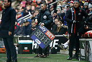 Fourth Official James Mainwaring with the board indicating substitutions and added time, during the EFL Sky Bet League 1 match between Fleetwood Town and Blackpool at the Highbury Stadium, Fleetwood, England on 25 November 2017. Photo by Paul Thompson.