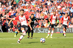 Southampton's Charlie Austin scores his side's third goal of the game from the penalty spot during the Premier League match at St Mary's, Southampton.