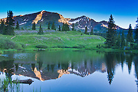 Reflections of Ruby Peak (left) and Mount Owen of the Ruby Range in a small pond near Lake Erwin, Colorado.