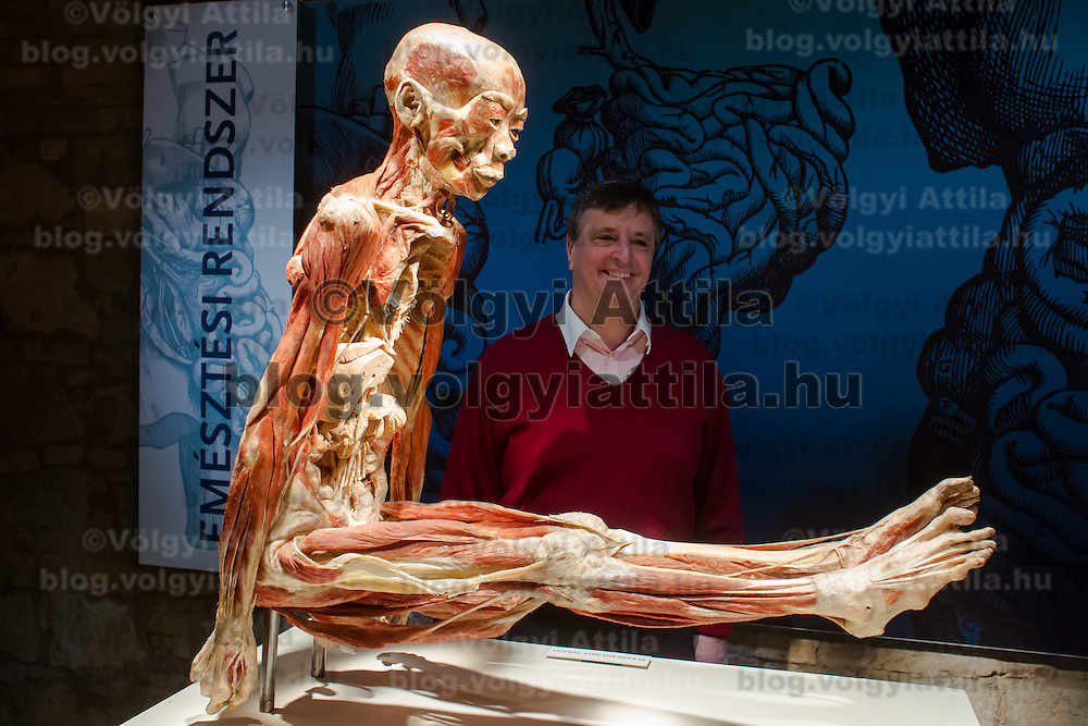 Hungarian Olympic champion Zoltan Magyar (back) watches a preserved human body on display at an exhibition in Budapest, Hungary on April 02, 2012. ATTILA VOLGYI