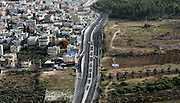 Aerial view of Arab village of Jadeidi-Makr, Galilee, Israel. Highway 70 in the centre