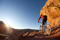 "Man mountain biking the ""North 40"" trail near the Bar M area. Moab, Utah."