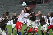 Fussball: 2. Bundesliga, FC St. Pauli - Hamburger SV, Hamburg, 01.03.2021<br /> Simon Terrode  (HSV, l.) - James Lawrence (Pauli)<br /> © Torsten Helmke