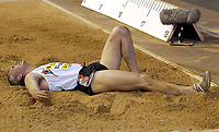 Photograph: Scott Heavey<br />IAAf Super Grand Prix. Norwich Union London Athletics meeting from Crystal Palace. 08/08/2003.<br />Jonathan Edwards lays in pain.