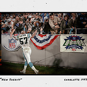Carolina's Lamar Lathon celebrates with fans after the Panthers upset the Dallas Cowboys in the NFC Divisional Round in 1997. ©Travis Bell Photography