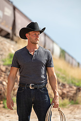cowboy by a moving train