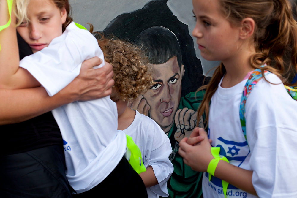 Supporters of Israeli captured soldier Gilad Shalit are seen outside a protest tent set to call for his release, near Prime Minister Netanyahu's residence in Jerusalem, July 13, 2010.