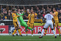 Football - 2016 / 2017 FA Cup - Fourth Round: Sutton United vs. Leeds United<br /> <br /> Sutton goalkeeper Ross Worner punches clear from team mates Simon Downer and Maxime Biamou (left) at Gander Green Lane.<br /> <br /> COLORSPORT/ANDREW COWIE
