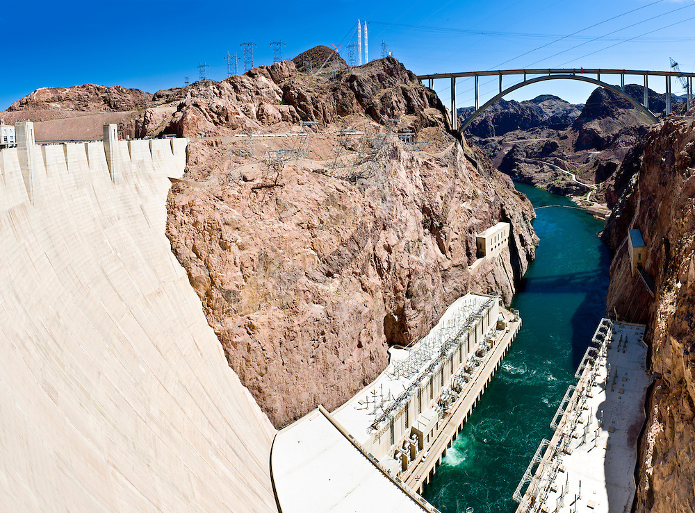 Panoramic view of Hoover Dam and baypass bridge. Hoover Dam, is a popular tourist destination and was once known as Boulder Dam, is a concrete arch-gravity dam in the Black Canyon of the Colorado River, on the border between the US states of Arizona and Nevada. It was constructed between 1931 and 1936, and was dedicated on September 30, 1935 by President Franklin Roosevelt.