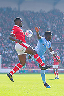 Dimitri Cavare of Barnsley (12) and Brandon Mason of Coventry City (3) in action during the EFL Sky Bet League 1 match between Barnsley and Coventry City at Oakwell, Barnsley, England on 30 March 2019.