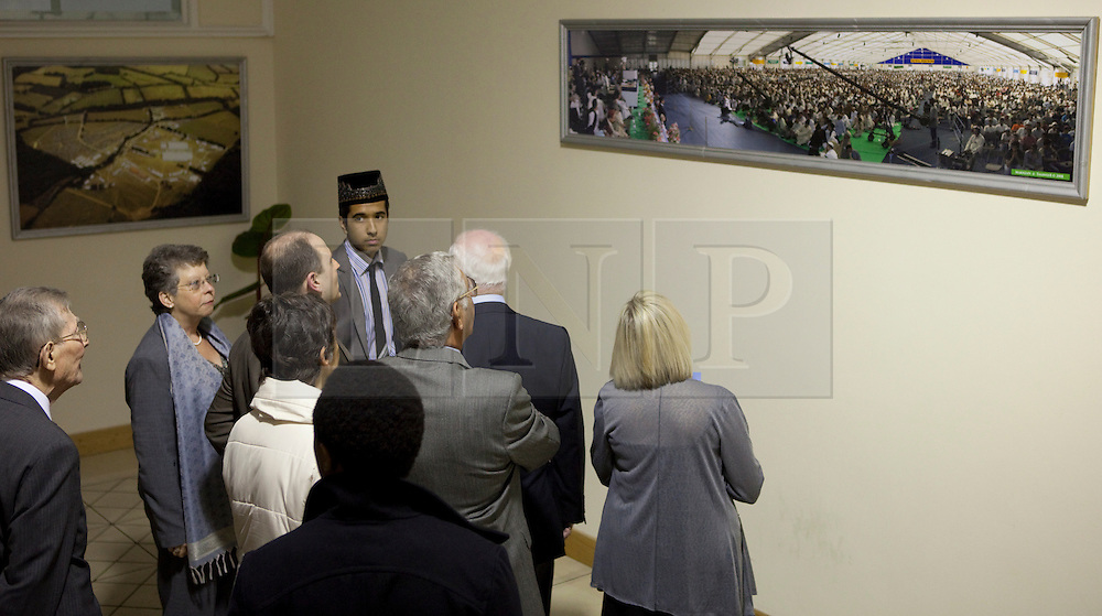 © Licensed to London News Pictures. 24/03/2012. Surrey, U.K..Visitors on a tour Europe's largerst mosque, Baitul Futuh Mosque, in Morden, Surrey, which holds 10,000 worshipers. .Parliamentarians and religious, civic, charitable and community leaders meet here this evening 24/3/2012 for a National Peace Symposium on International Peace organised by the Ahmadiyya Muslim community to hear how Muslims are countering extremism..Photo credit : Rich Bowen/LNP