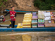 16 JUNE 2015 - SUNGAI KOLOK, THAILAND: A man from Malaysia brings soft drinks and consumer goods to Sungai Kolok, Thailand. The border between Thailand and Malaysia in Sungai Kolok, Narathiwat, Thailand. Thai and Malaysians cross the border freely for shopping and family visits. The border here is the Kolok River (Sungai is the Malay word for river).        PHOTO BY JACK KURTZ