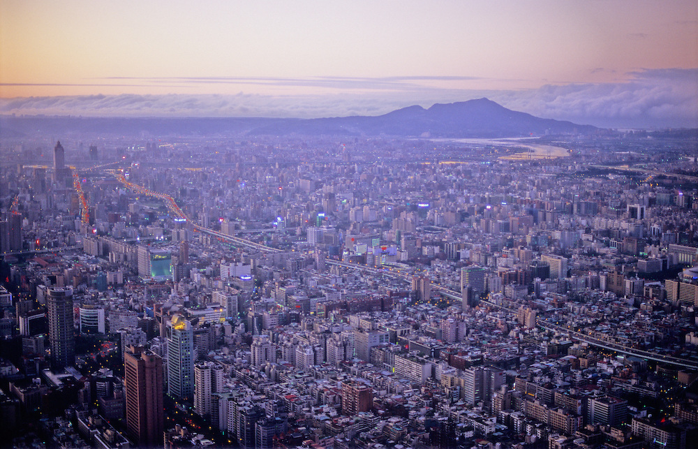 View from the observation deck of Taipei 101. The sun sets over Taipei, Taiwan's capital city and metropolis. Formerly the tallest building in the world and now Taiwan's tallest building.