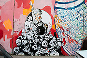Egypt, Cairo 2014. Mohammed Mansour Street. Revolutionary graffiti. image of policeman with skulls and angel's wing