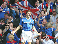 Football - Scottish Premier League - Rangers vs. Celtic<br />  <br /> Andrew Little of Rangers celebrating his goal with his first touch of the ball after coming on as a substitute during the third Old Firm encounter of the season during the Rangers vs Celtic Scottish Premier League match at Ibrox Stadium Glasgow on March 25th 2012 <br /> <br /> Ian MacNicol/Colorsport