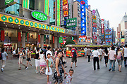 People out shopping on Shanghai's famous Nanjing Road. Famed for it's many department stores, bright signs and bustling streets.