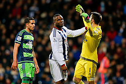 Victor Anichebe of West Bromwich Albion hassles Lukasz Fabianski of Swansea City - Mandatory byline: Rogan Thomson/JMP - 02/02/2016 - FOOTBALL - The Hawthornes - West Bromwich, England - West Bromwich Albion v Swansea City - Barclays Premier League.