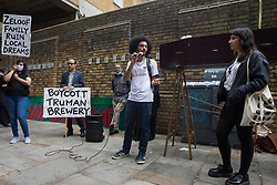 London, UK. 12th September, 2021. Kieran Kirkwood of Save Latin Village addresses local residents and supporters of the Save Brick Lane campaign outside the Truman Brewery following a funeral procession along Brick Lane organised in protest against the ongoing gentrification of Shoreditch. Campaigners are protesting in particular against plans to develop the Truman Brewery into a shopping centre and 5-storey office building. Tower Hamlets experienced more gentrification than any other London borough between 2010-2016.