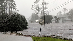 October 10, 2018 - Florida, U.S. - Hurricane Michael formed off the coast of Cuba carrying major Category 4 landfall in the Florida Panhandle. Surge in the Big Bend area, along with catastrophic winds at 155mph. Storm surge floods 20th St in Port St. Joe on Wednesday morning after Hurricane Michael makes landfall in the Florida Panhandle. (Credit Image: © Douglas R. Clifford/Tampa Bay Times via ZUMA Wire)