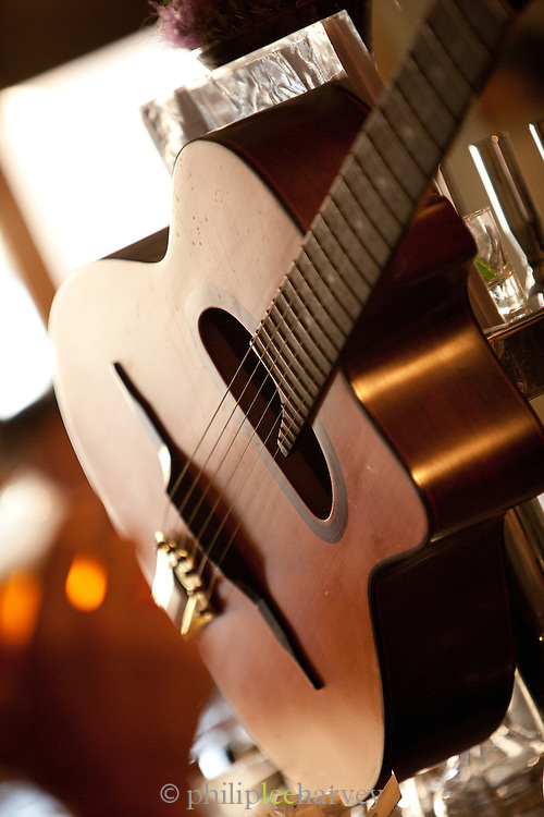 A guitar at a live music event at a bistro in the centre of Paris, France