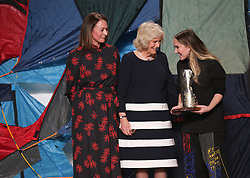 (left to right) Chief Executive of the British Fashion Council, Caroline Rush, the Duchess of Cornwall presenting the Queen Elizabeth II Award for British Design to Bethany Williams during the Autumn/Winter 2019 London Fashion Week show at the BFC Show Space, London.